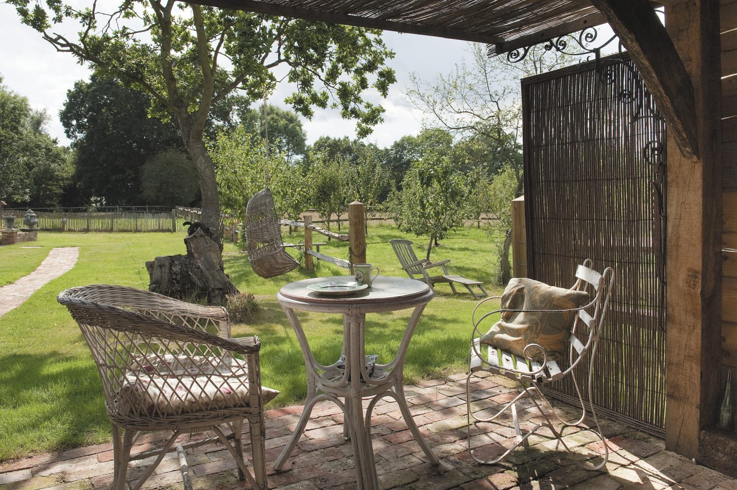 the summerhouse looks out onto the orchard