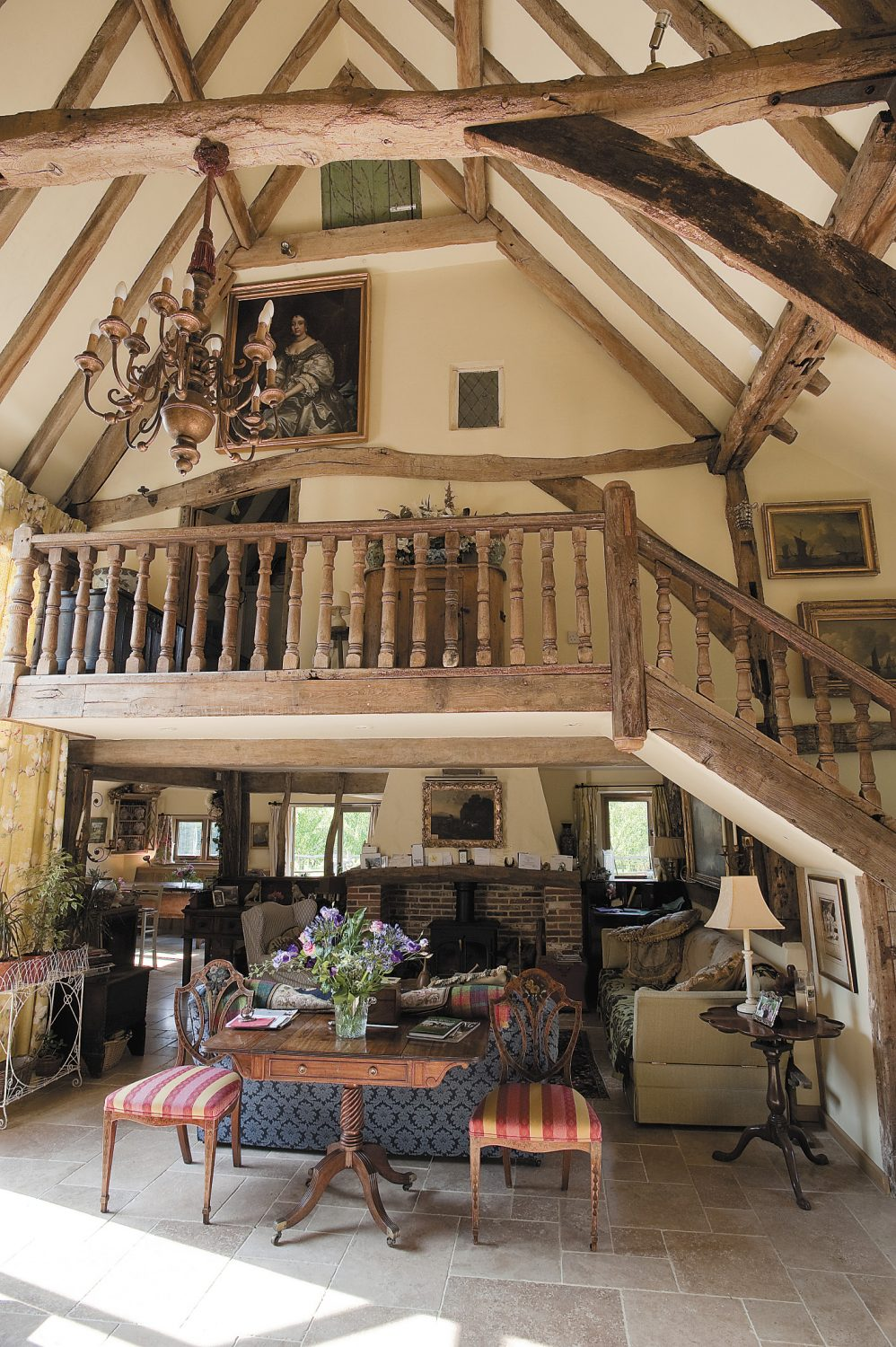 the main downstairs space is a soaring vault of a room, the floor of light travertine marble. Molly is now a true reclamation junkie, and entering the front door, one's greeted by one of her greatest finds – a magnificent oak staircase, bought at a reclamation auction