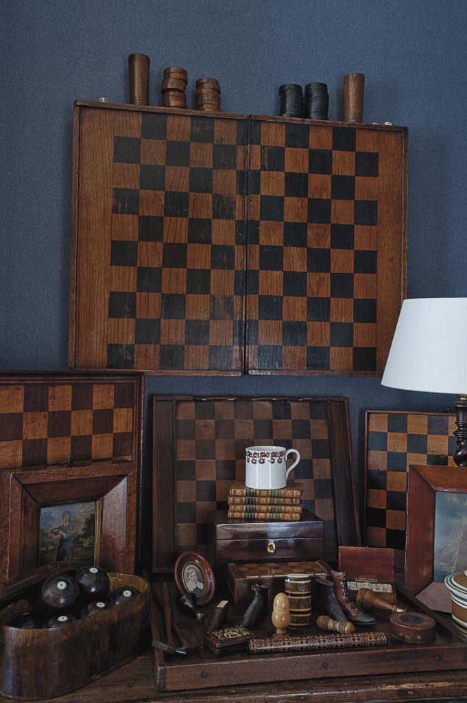 Dee's collection of antique games boards and wooden decorative objects provides a talking point for guests