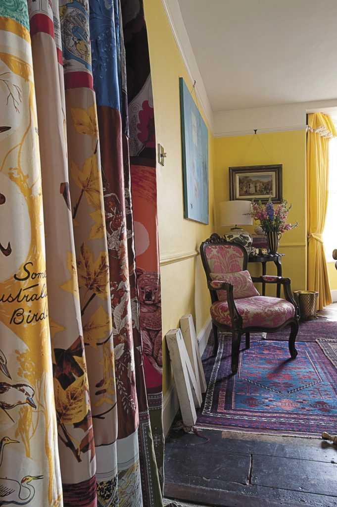 the fauteuil-style chairs are covered in Designer's Guild devoré velvet. Maggie made the window curtain out of her large collection of silk scarves