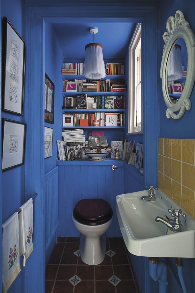 the loo, which doubles as a library and art gallery is Maggie's favourite room in the house