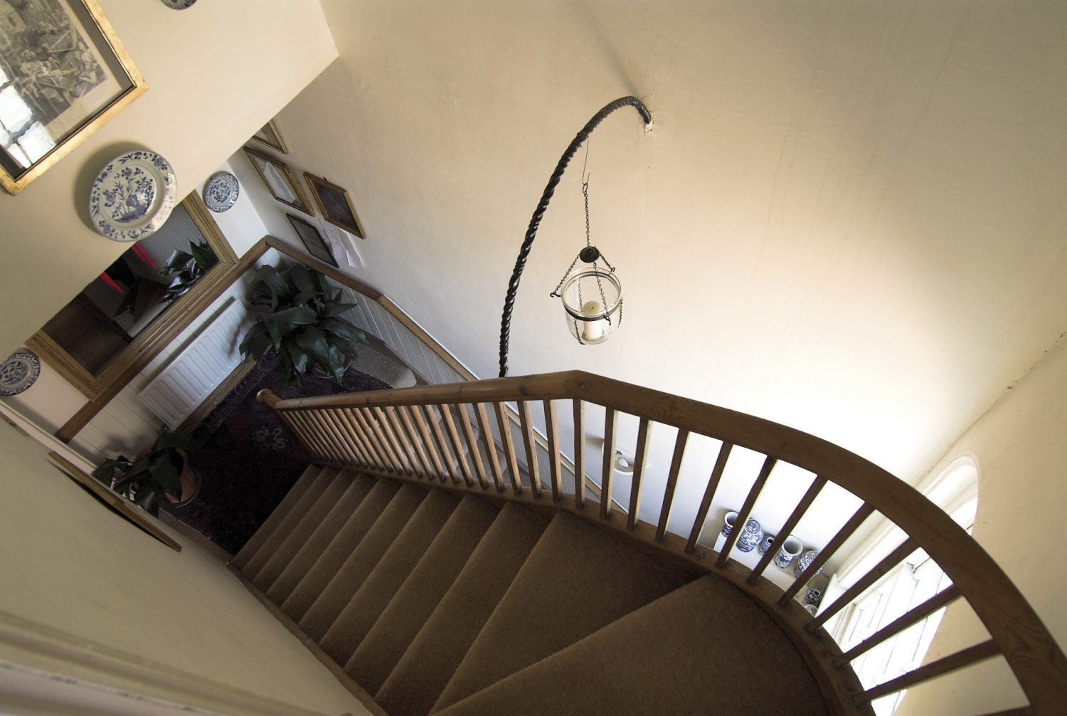 The vertigo-inducing staircase leads up to Bob's bedroom from the first floor