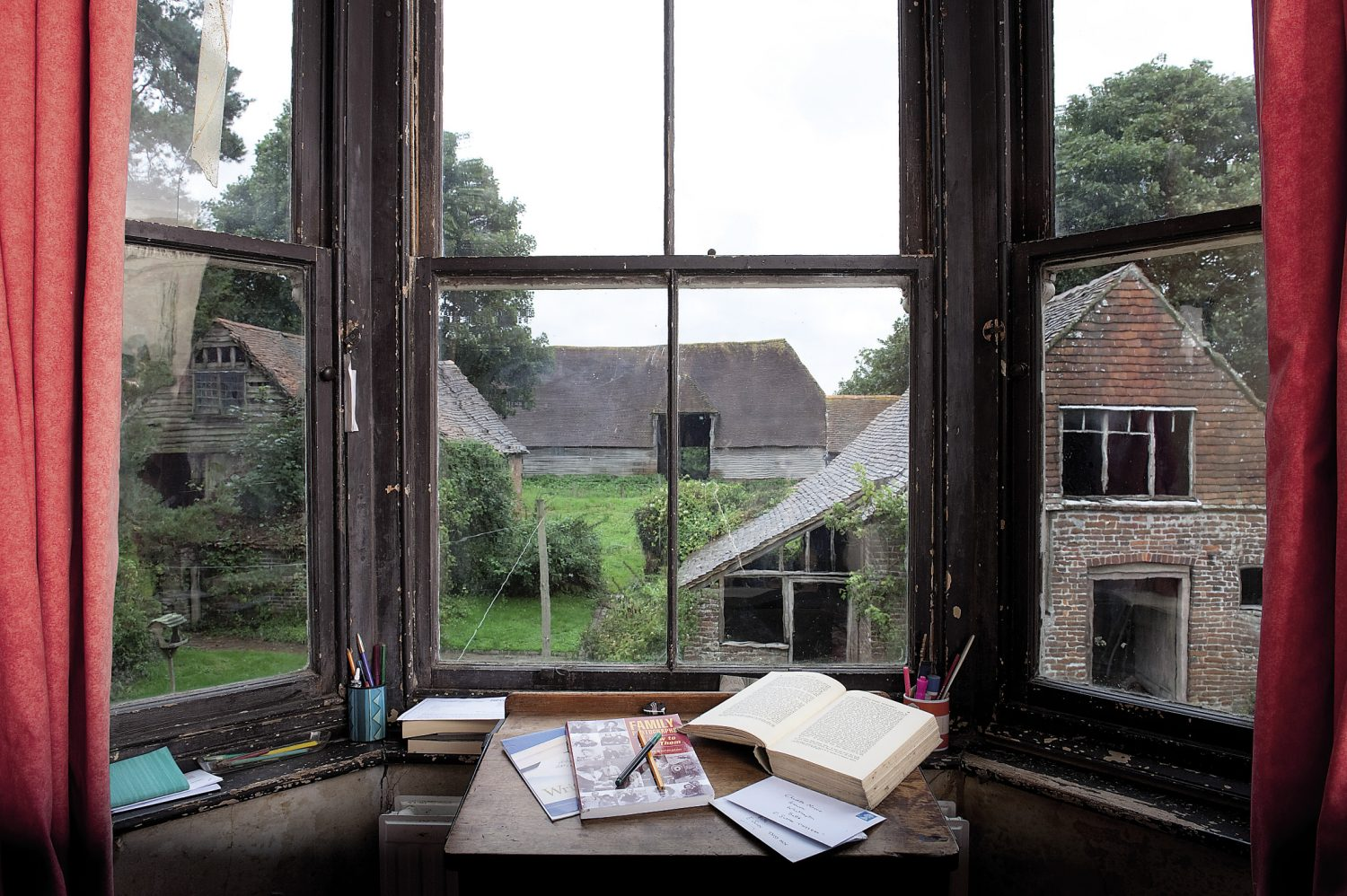 "Charlotte's writing desk looks out over the farm buildings. ""I can see the great roof of our cathedral-like barn, the stables, the old coach house and the brew house. It's a view that hasn't changed for several hundred years."""