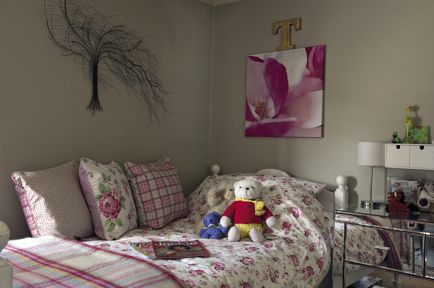 Even the pretty bedroom of a visiting child is complete with perfectly-placed finishing touches, including a vintage Jackie magazine