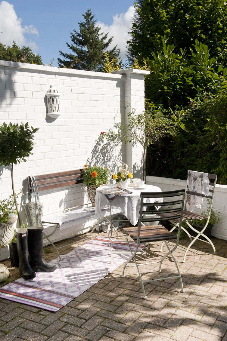 The decked terrace encircles an ancient yew tree and sweeps around the weatherboarded house that is perched at the summit of a high ridge