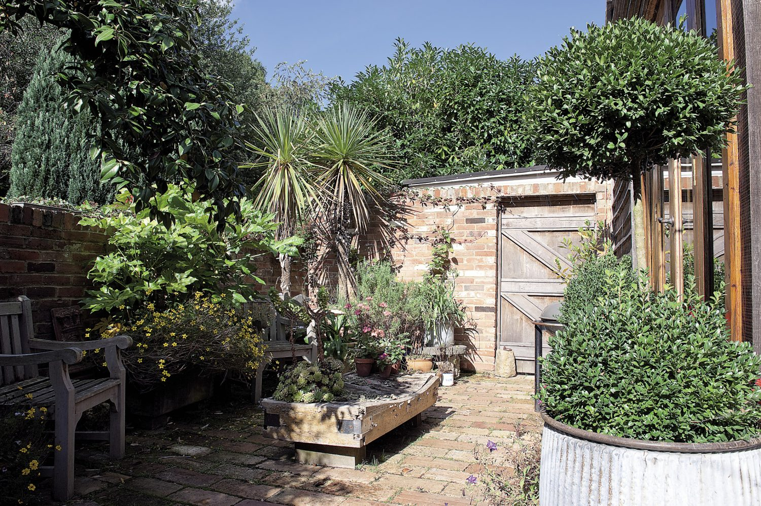 The walled, partially-decked courtyard garden is the perfect summer hideaway