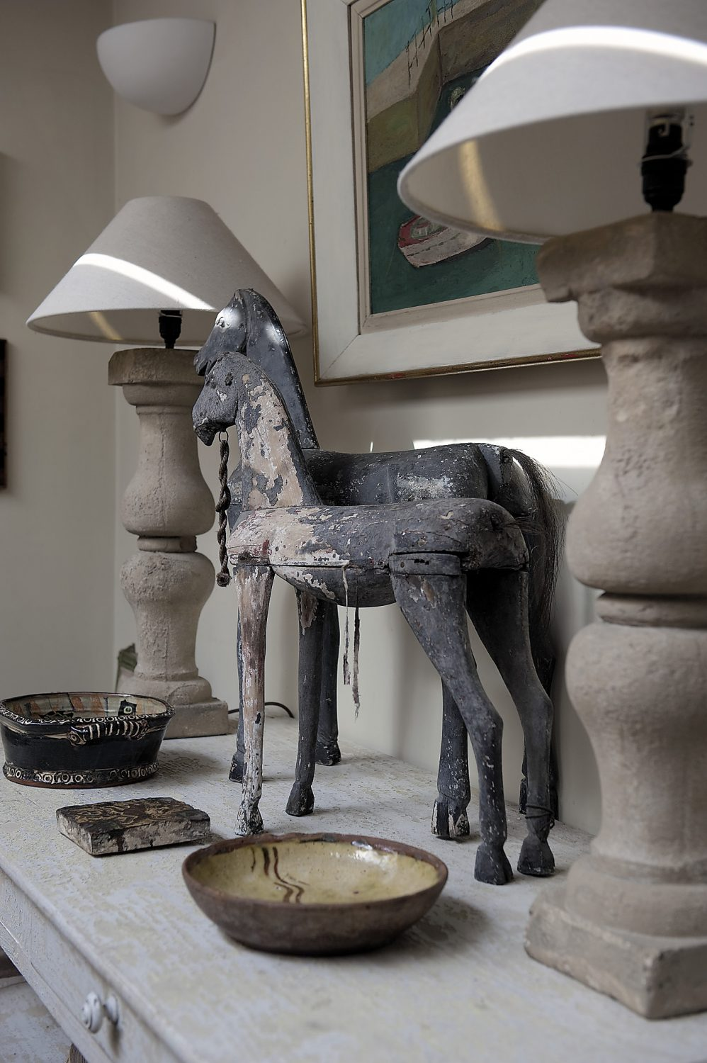 James' house is filled with artworks, ornaments and curios, the most striking of which are a pair of toy wooden horses