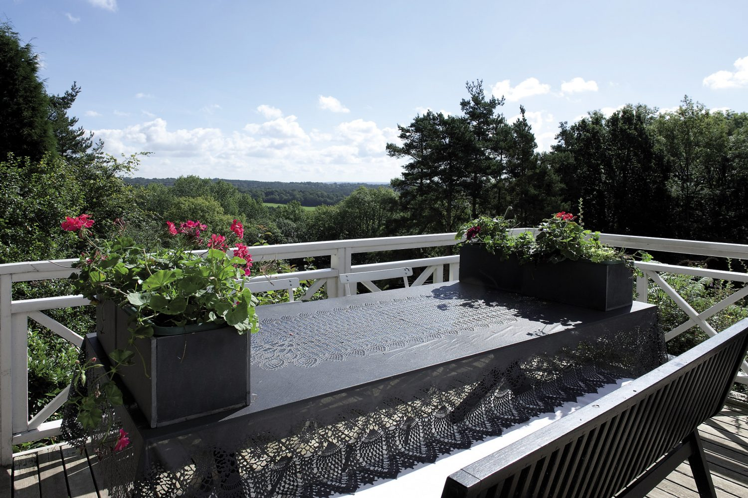 """Before we enter the house we follow Andrew to the terrace at the rear of the property. """"This is what sold the place to me,"""" he says, gesturing towards what is an incredible view across the Ashdown Forest. """"I saw this and knew I'd found my house."""""""