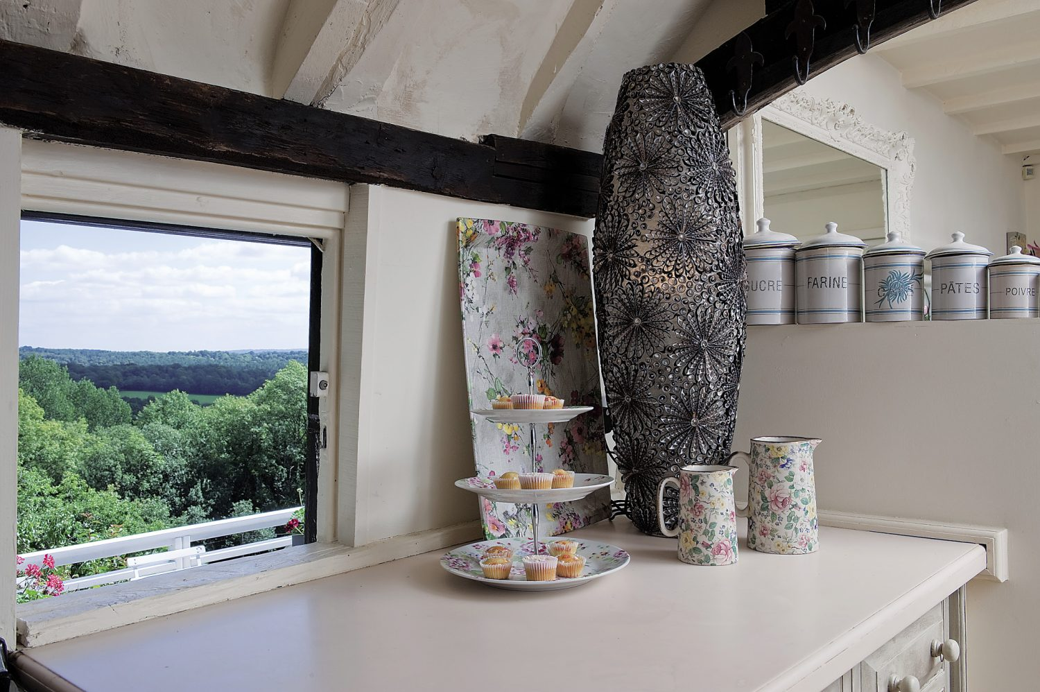 The view from the kitchen window overlooks the terrace at the rear of the property