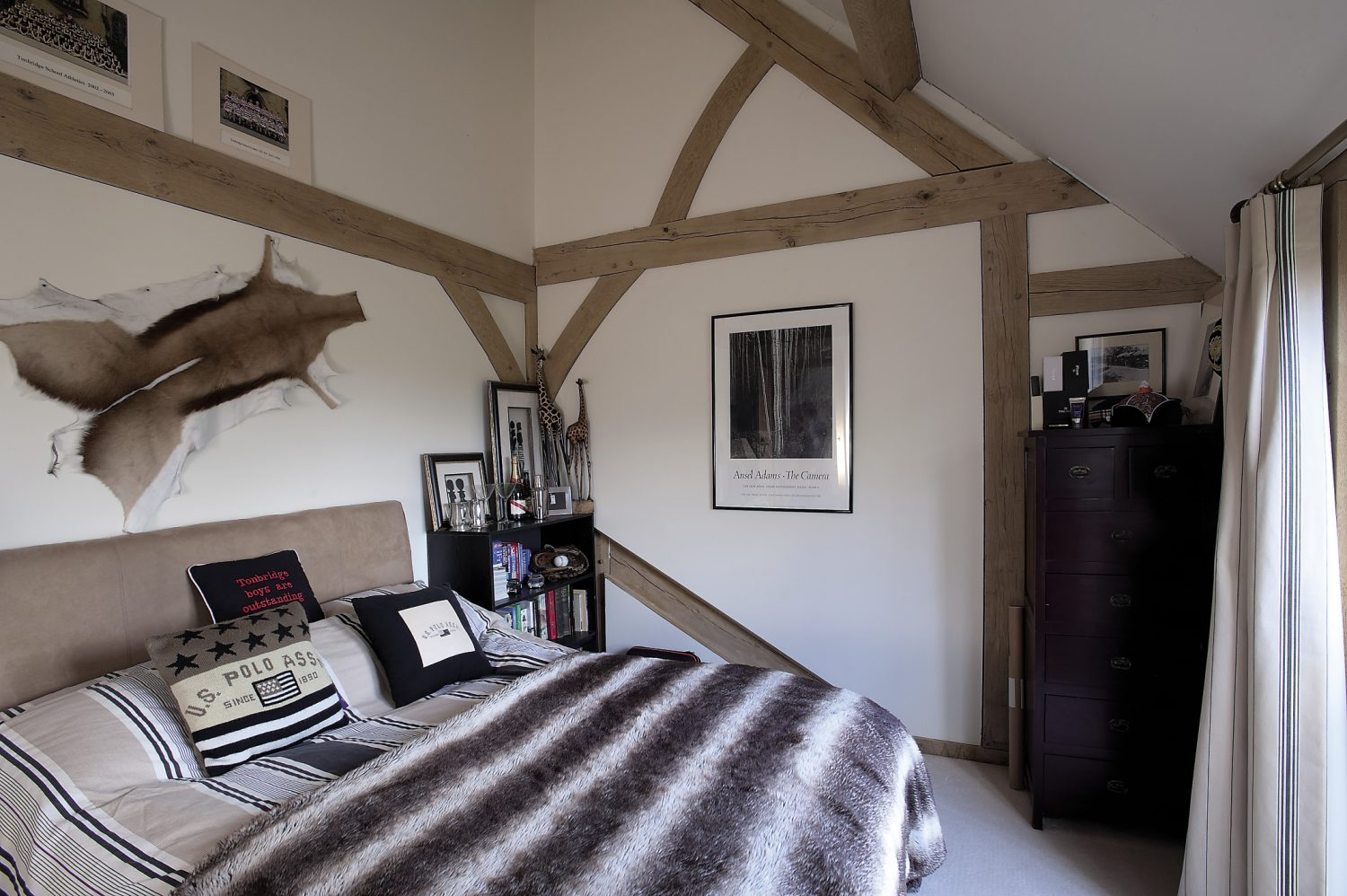 Teddy's room displays masses of school, university and sports team pictures along with artefacts collected from South Africa, while his younger brother Patrick reveals his love of music in a room that is full of guitars and vintage posters