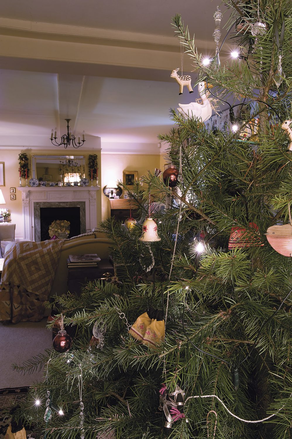 the Christmas tree in the drawing room has traditional decorations which have been collected by the family over the years