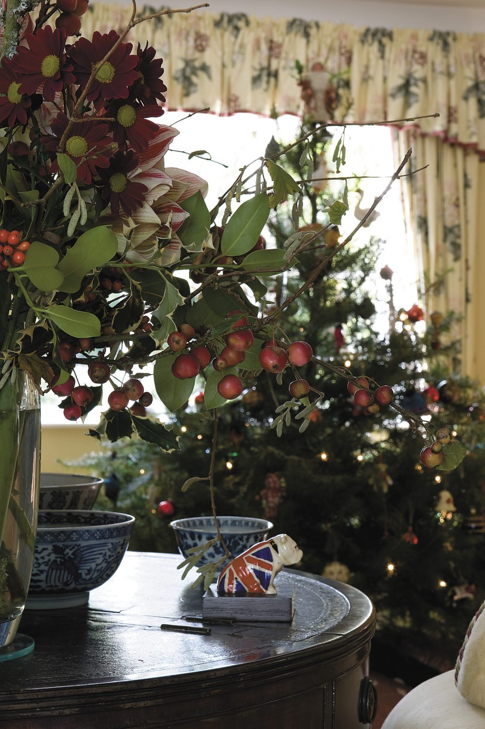 the Christmas tree stands in front of the drawing-room window