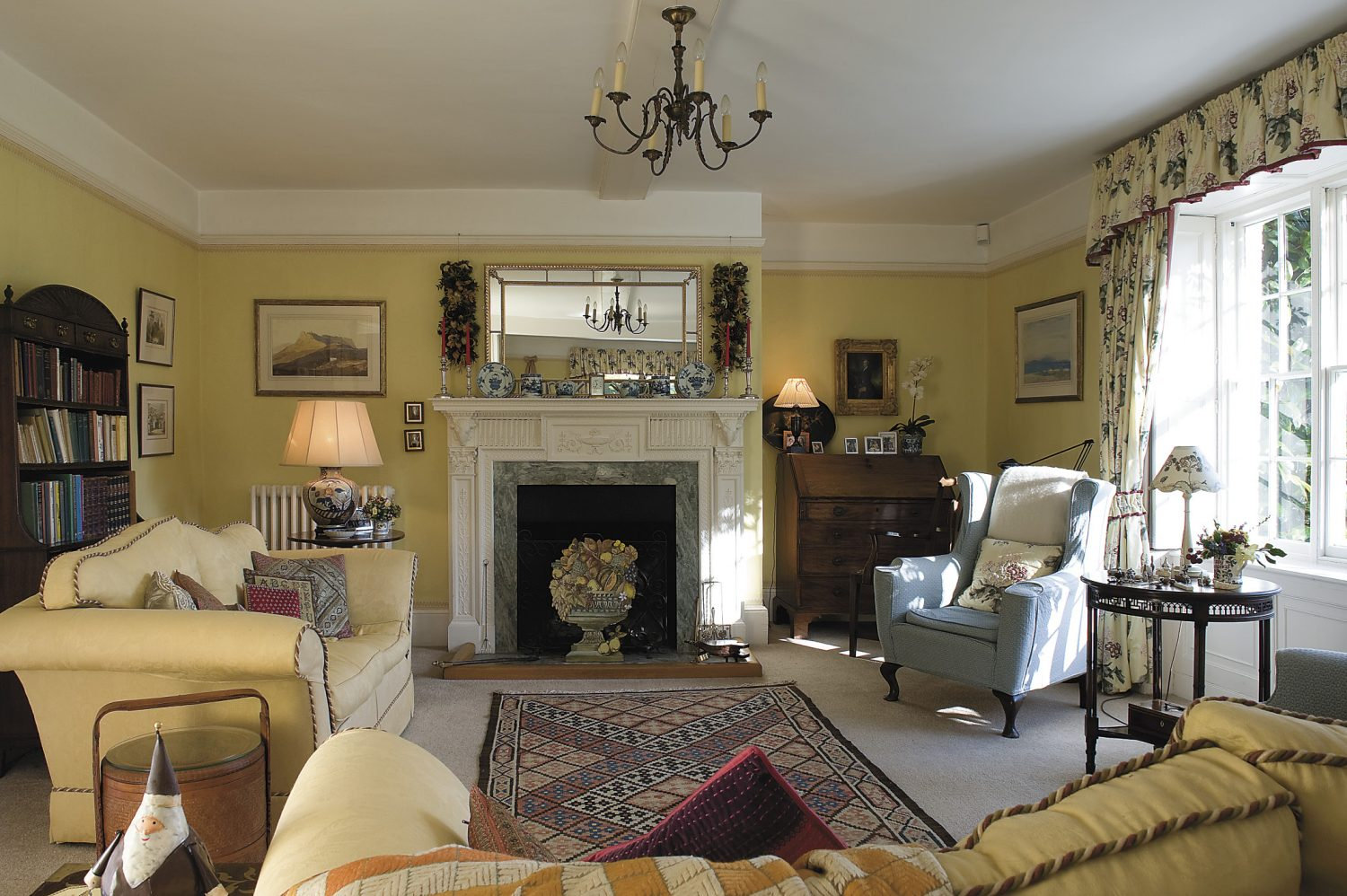 the drawing room is in the Georgian part of the house and its large windows flood the room with light