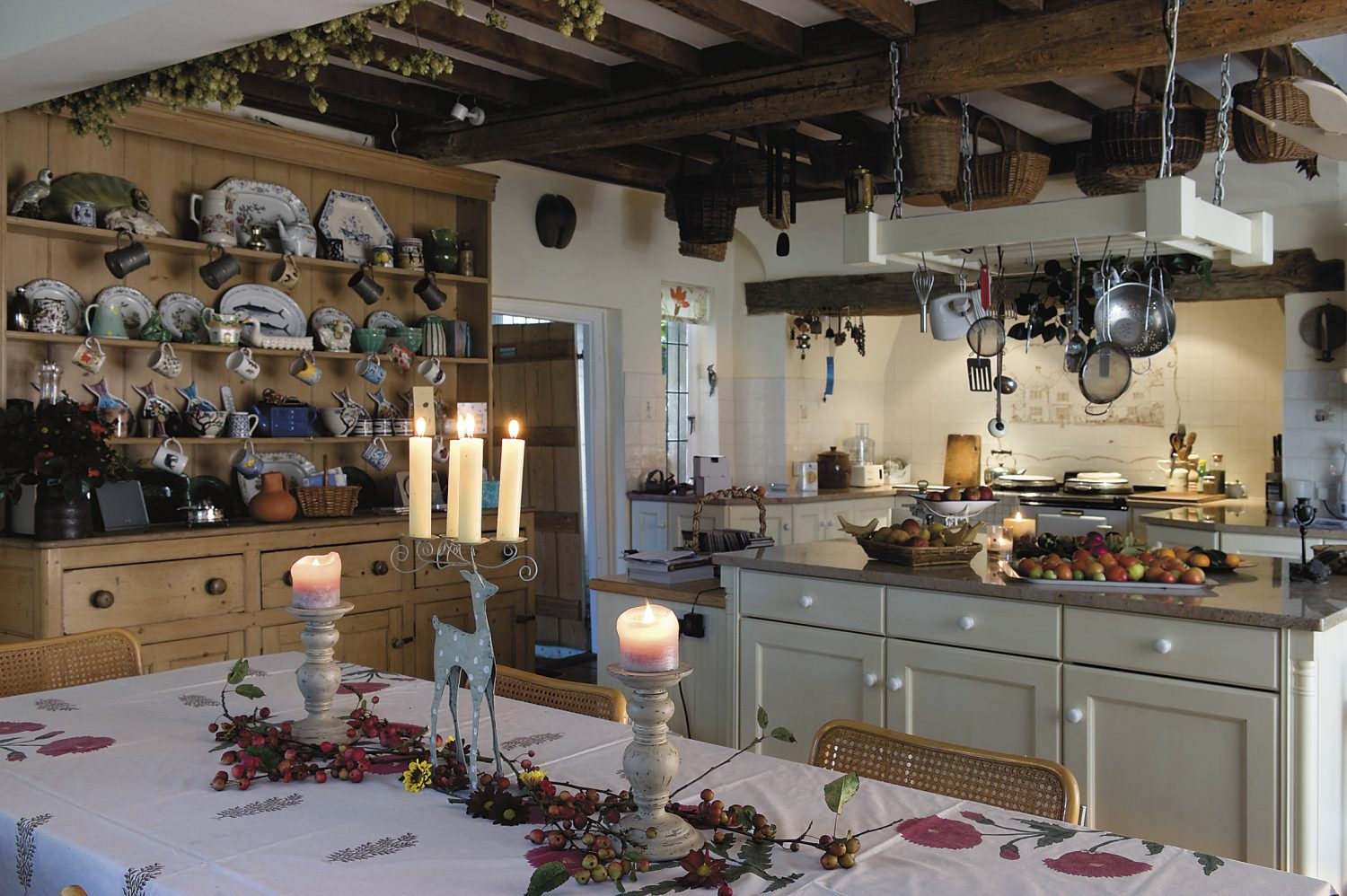 the large kitchen is warmed by an Aga, a boon on power-cut days, and the large dresser is from the house where Jemima was brought up