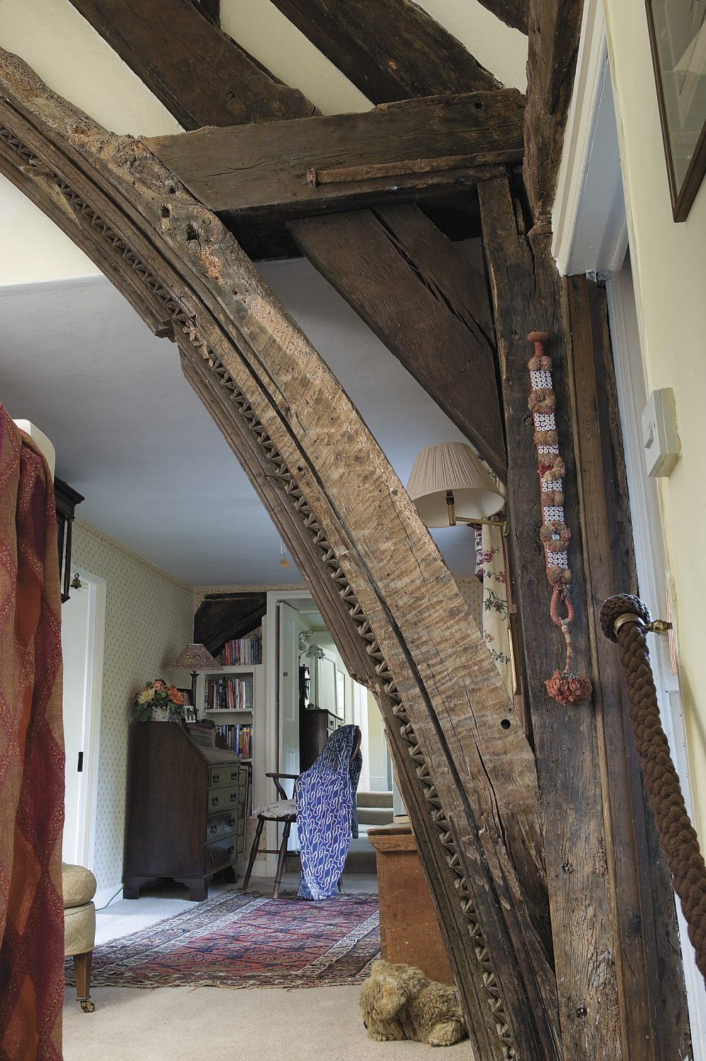 part of the decorated arched oak beam uncovered 30 years ago