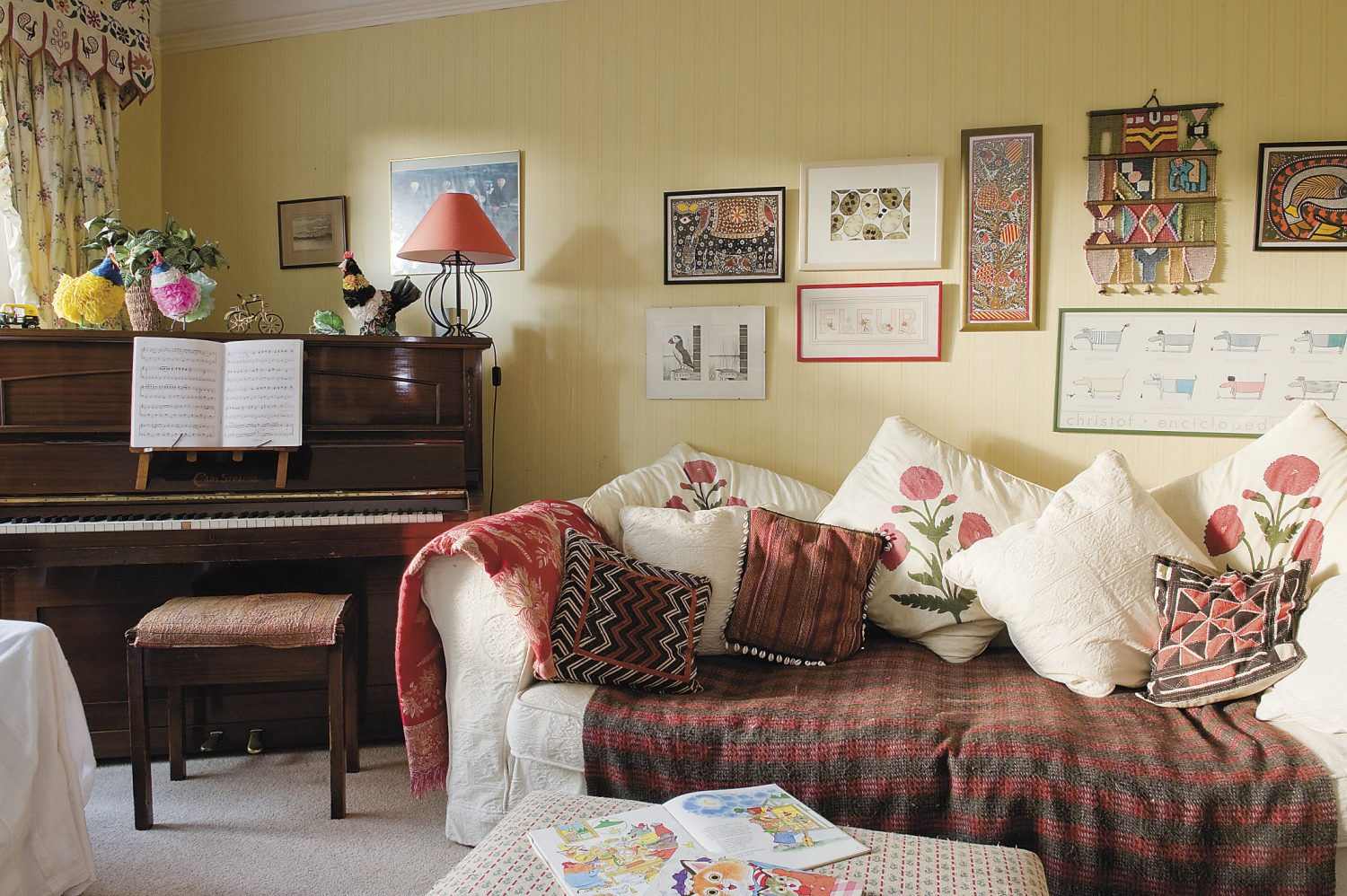 cushions, throws and artworks gathered on trips overseas add a splash of Eastern colour to a traditional Wealden hall house