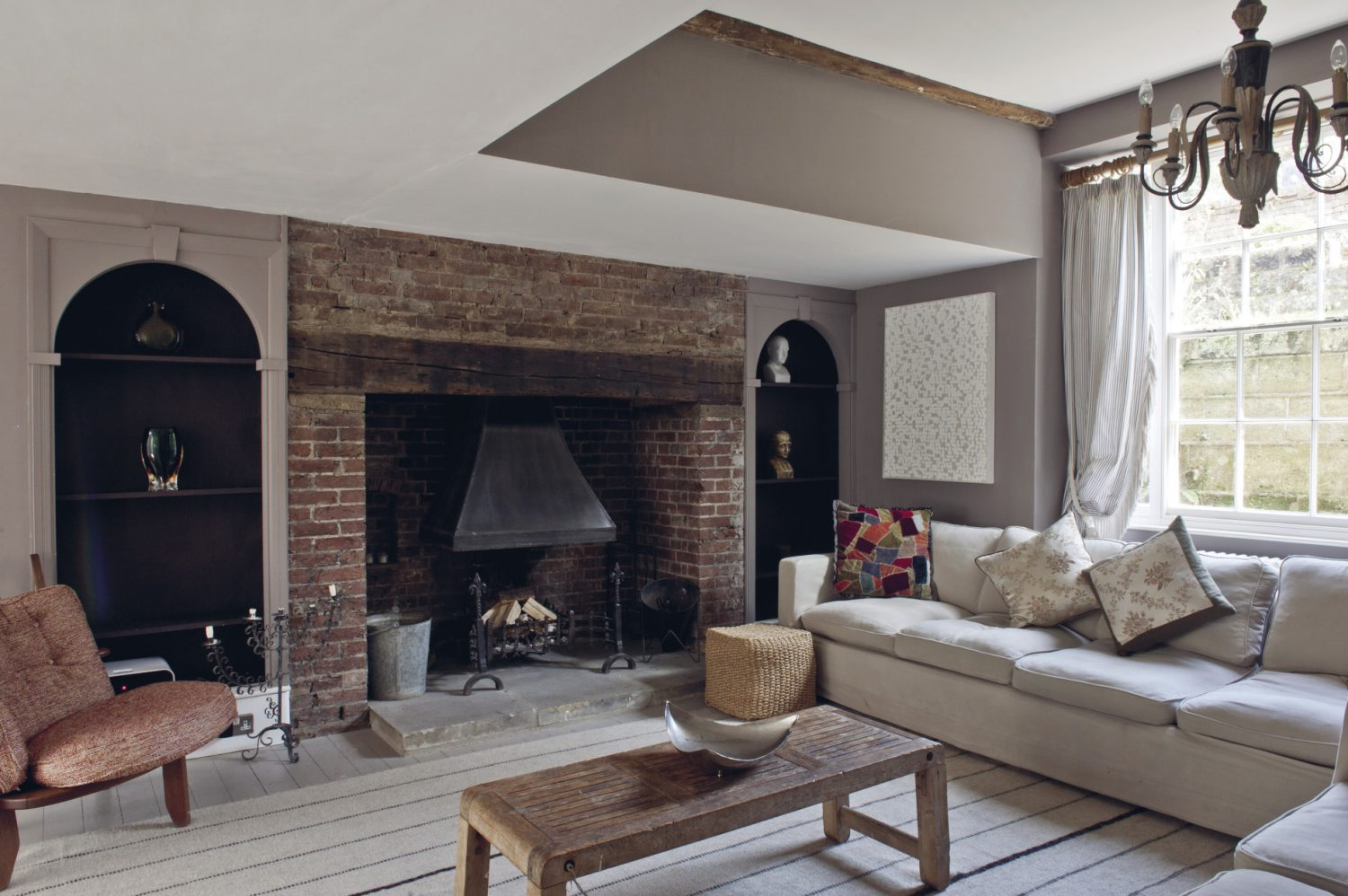At the other end of the sitting room, two huge comfortable sofas are placed around an original inglenook where log fires burn in the winter months