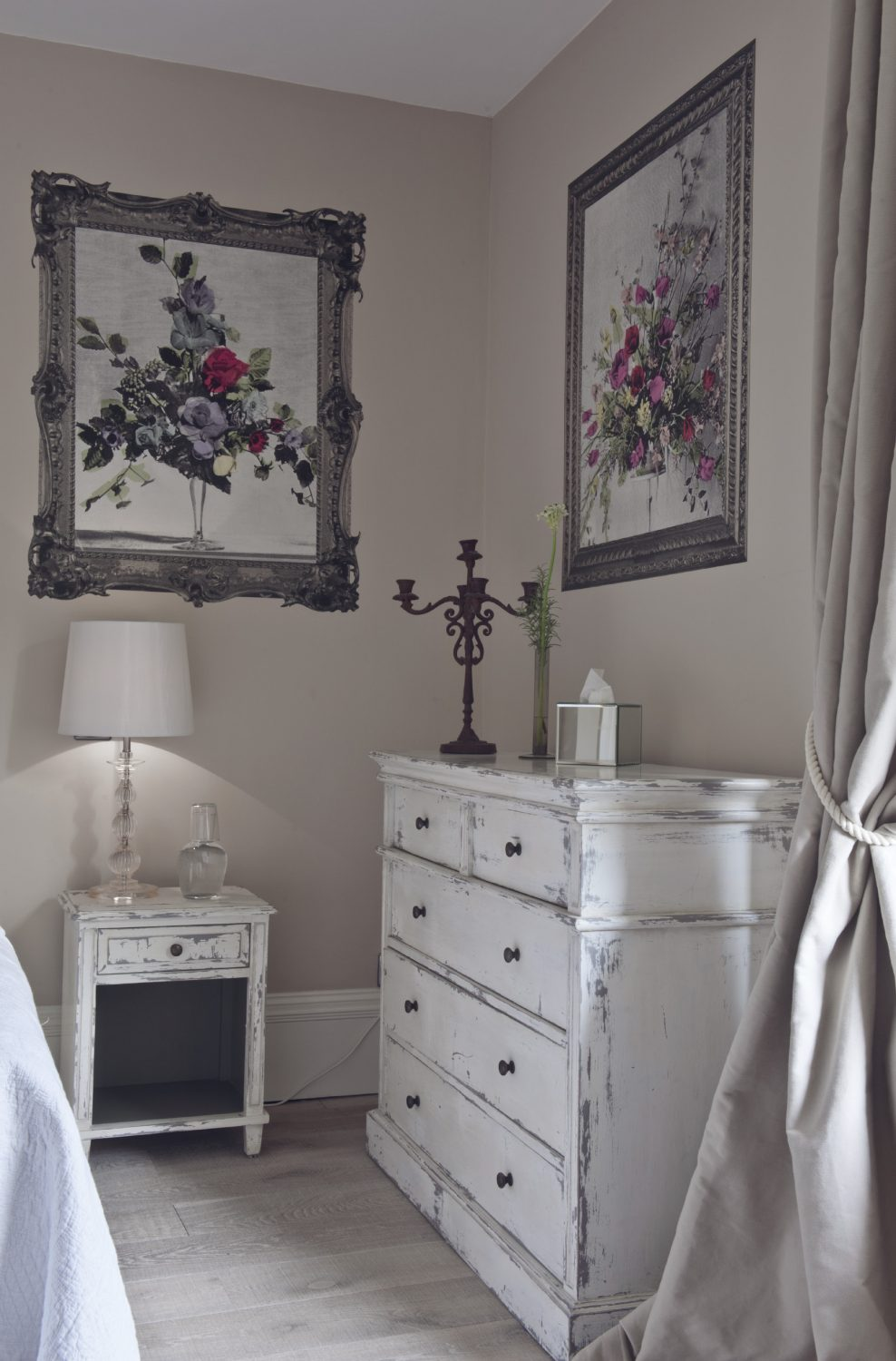 Designer Deborah Bowness' unique floral wall pieces take centre stage in the airy Croft bedroom