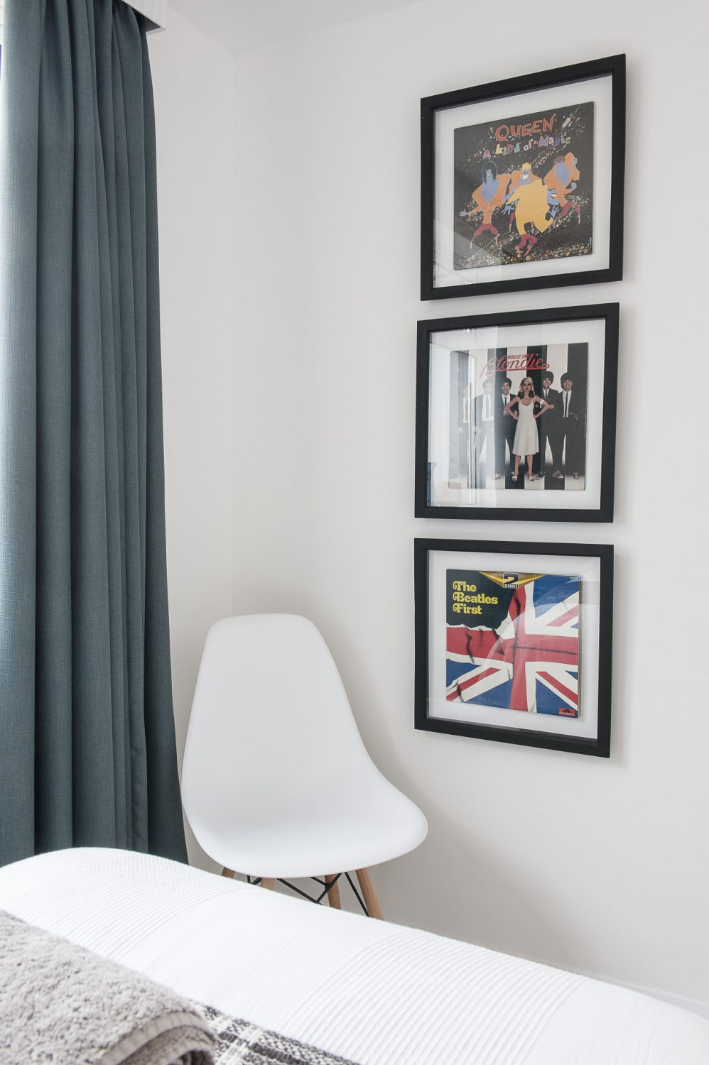 A trio of framed album covers are mounted onto one wall