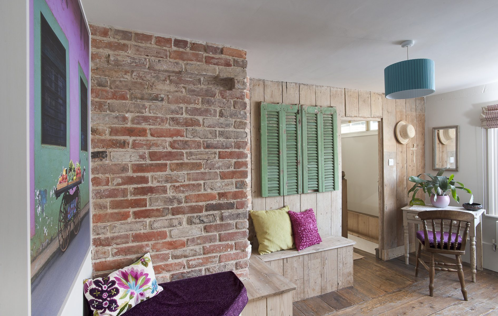 In the spacious study green French shutters have been used as cupboard doors. Where pipes have been 'boxed in' seats have been created