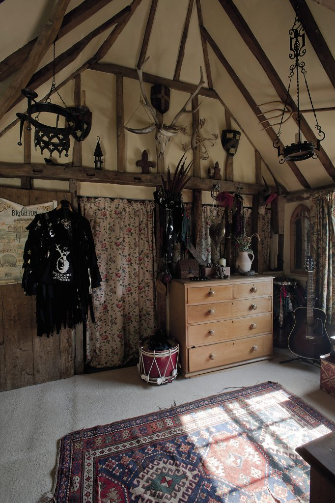 The square room at the top of the stairs is used as a dressing room and a sort of props cupboard. There are Viking leather pouches, drenching horns and Claudine's Hunter's Moon Morris Side costume hangs from a beam