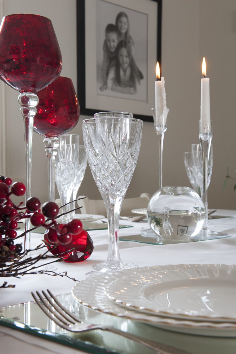 Steph and her friend Nicky have dressed the dining table with cut crystal glasses and cranberry glass goblets