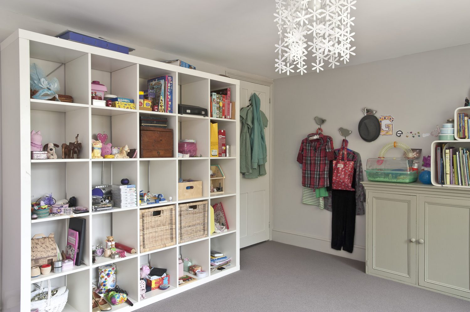 modular storage unit provides an attractive display whilst at the same time keeping the floor free of clutter