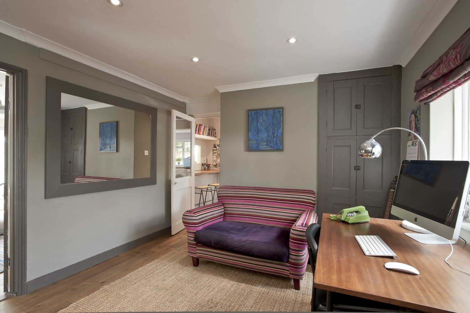 The sizeable hallway serves as a useful space. The walls are painted in Marston & Langinger 'Umber'