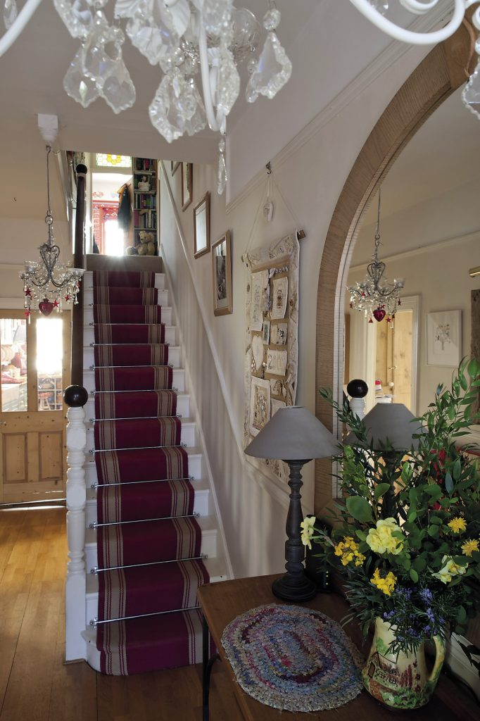 The stairs are covered with a smart red and cream Roger Oates' runner