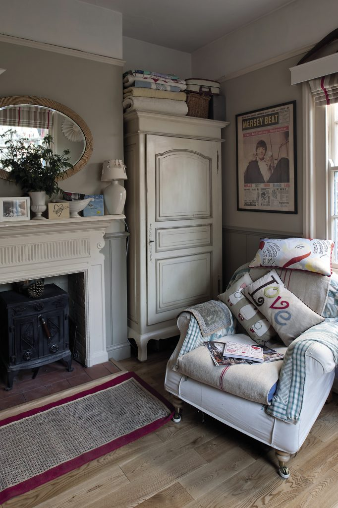 The study, painted in two shades of muted grey; the room has a serene feel, with armchairs covered with vintage linen and Mandy's embroidered cushions and blankets.