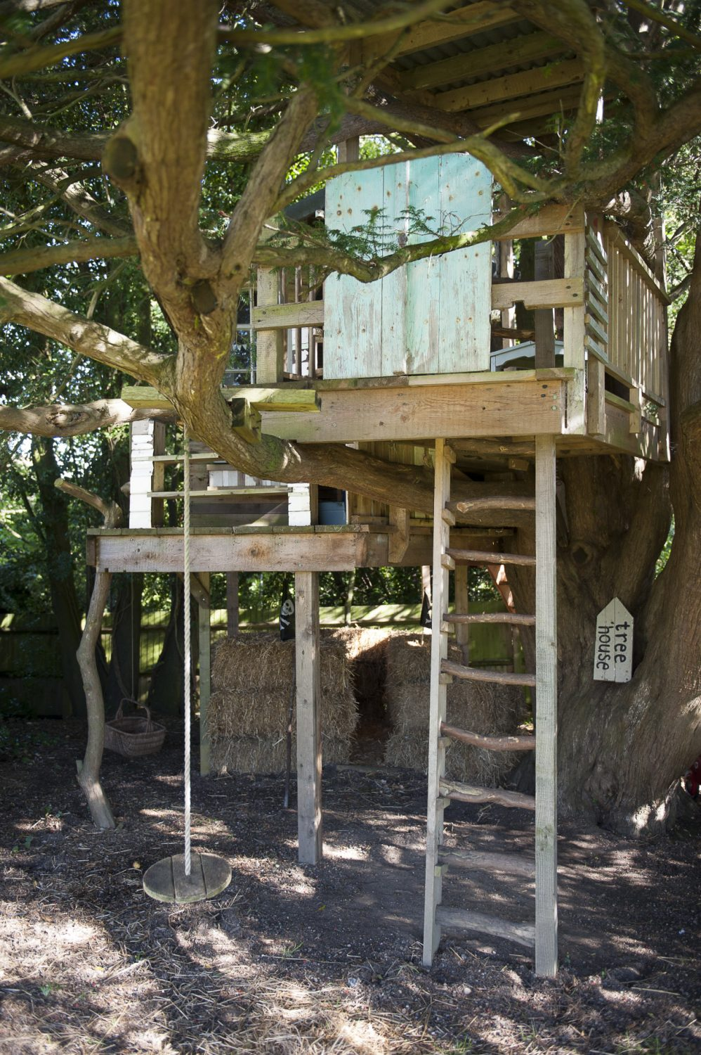 In the garden, an impressive treehouse was built by Rupert Walton, the children's godfather. There is both a rustic ladder and a staircase to the deck and the little cabin has been beautifully constructed from reclaimed materials including a fine Regency style arched window