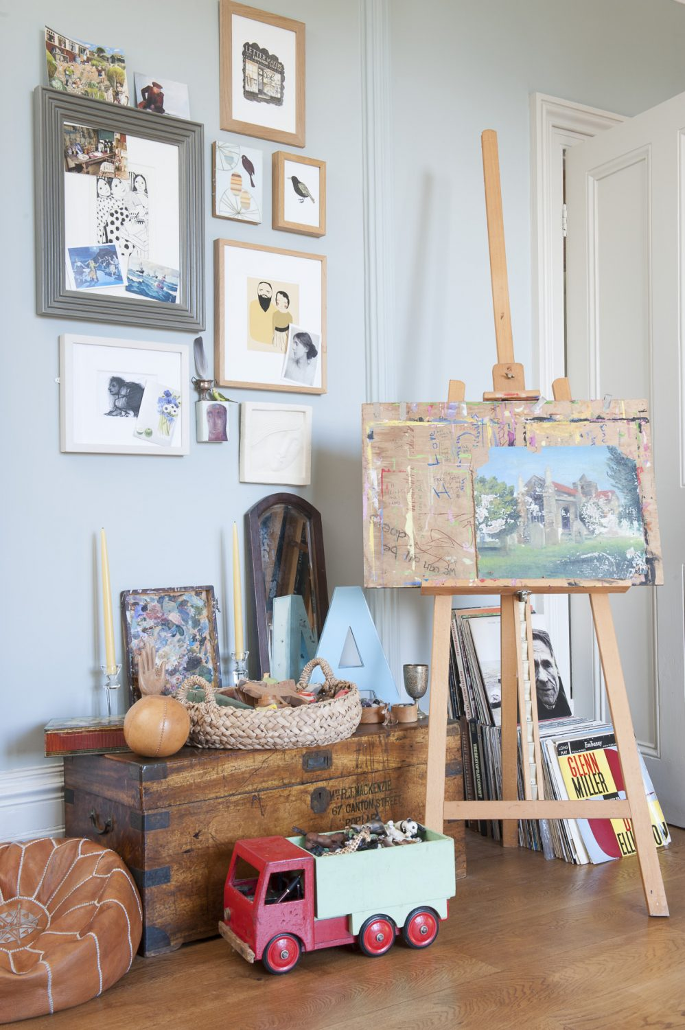 A riotous mix of oils, watercolours and pastel pictures and drawings line one wall