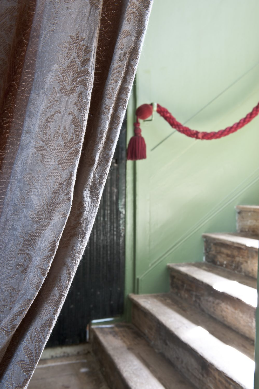 I follow Olga up a Farrow & Ball 'Chappell Green' painted staircase to the oak panelled Gallery