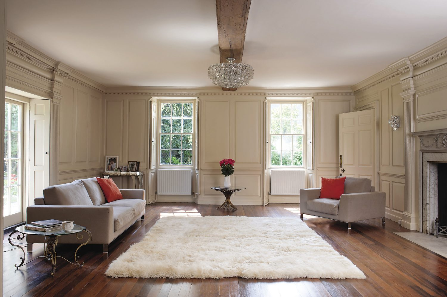 Two enormous grey-green painted panelled doors connect the drawing room with the simpler, but equally elegant morning room