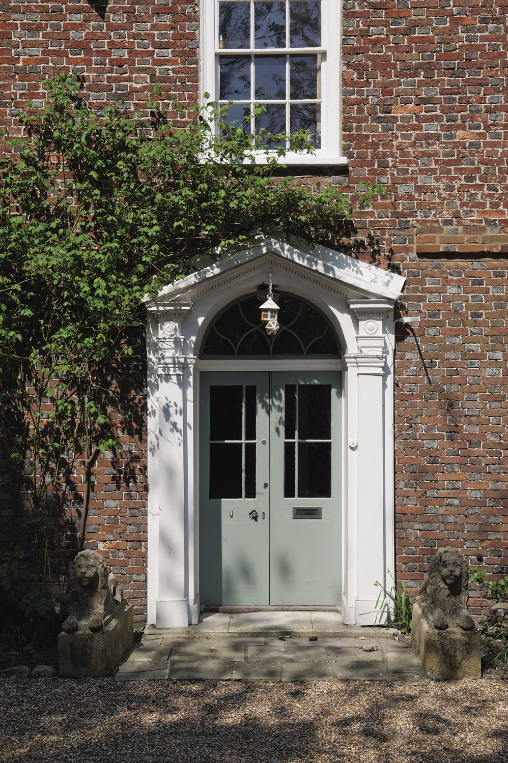 The front of the house is in the solid, sober style of 'farmer' George III. The beauty of its sash windows and the door with its simple fanlight above lies almost solely in the pleasing proportions of the architecture rather than any decoration