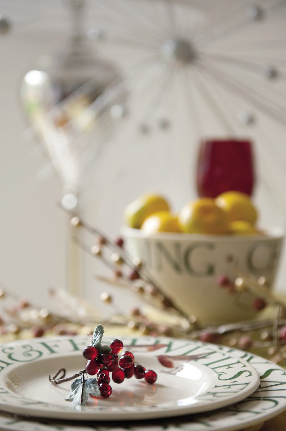 Juicy tangerines and mince pies sprinkled with glitter await guests nestled together on Kitty's Christmas crockery