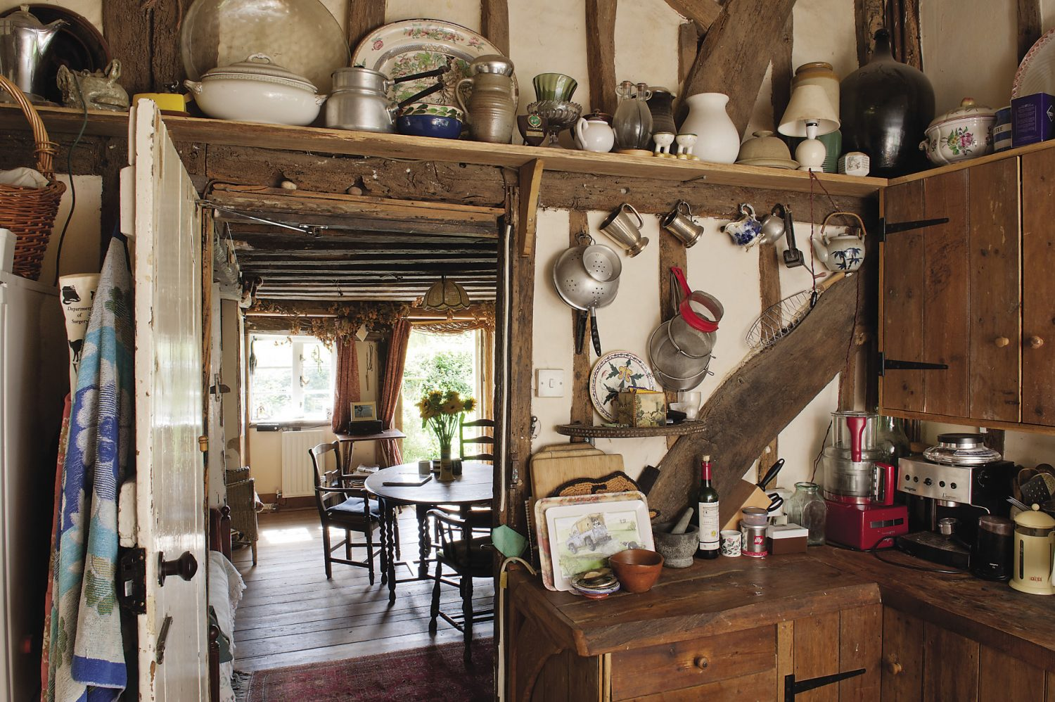 A door from what was once the medieval storeroom, now the dining room, leads into the kitchen
