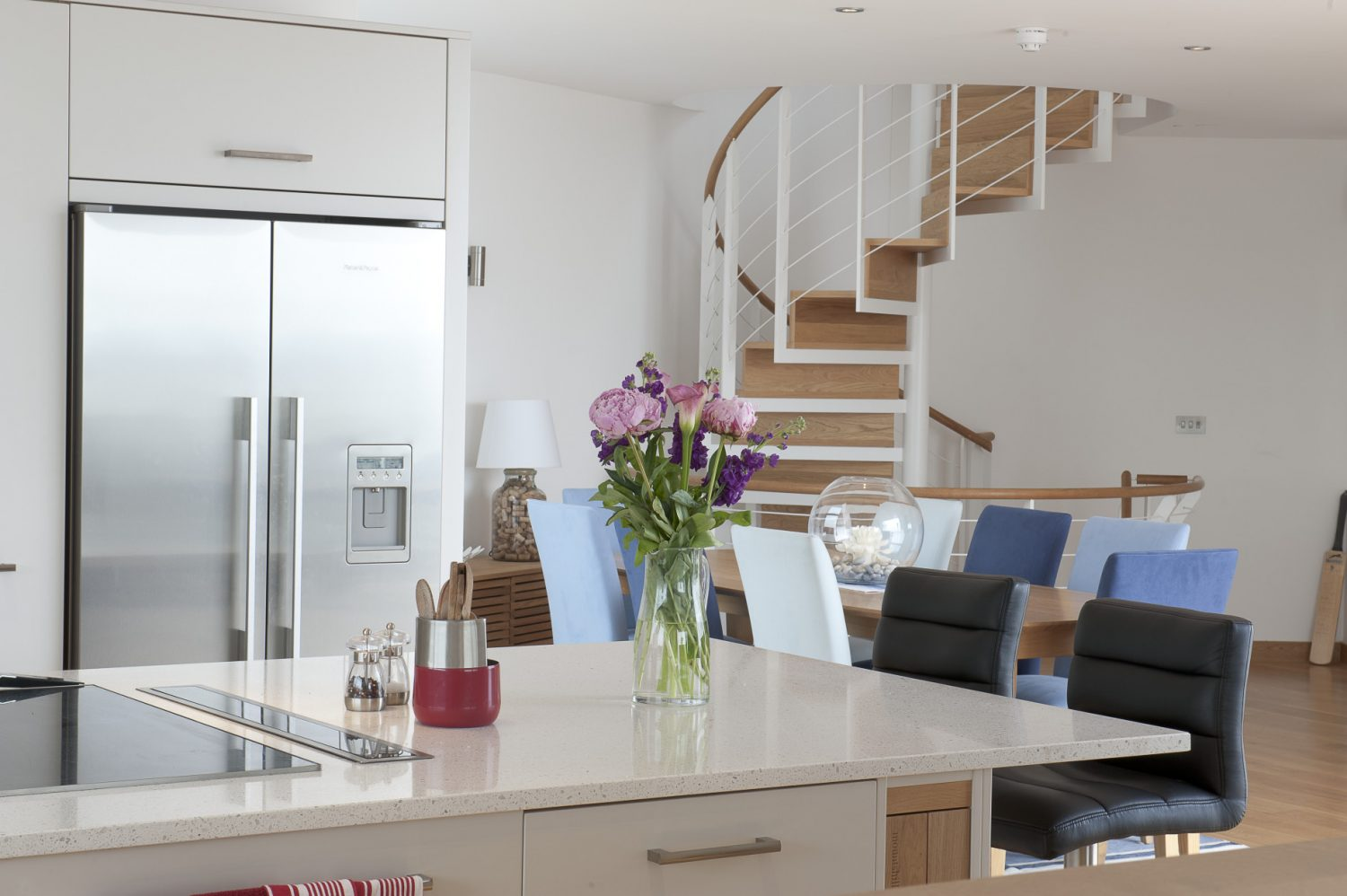 The kitchen, designed by Mounts Hill Woodcraft & Design, is sleekly efficient in appearance, with simple white cupboards and stainless steel appliances