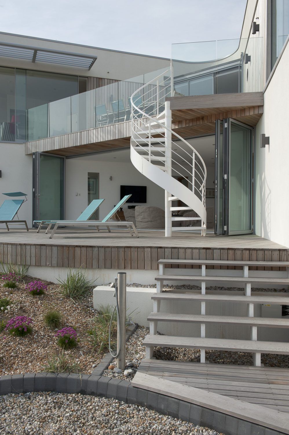 The spiral staircase is echoed outdoors
