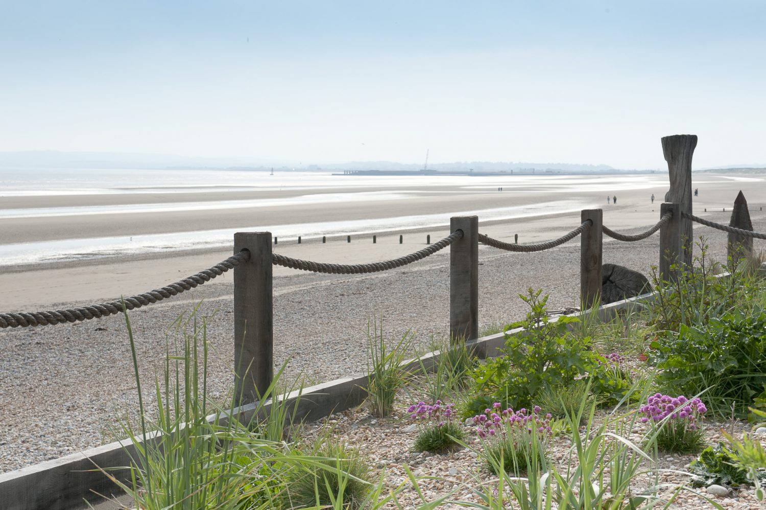 At the far end of the garden there is a sea defence with timber uprights linked by rope made at Chatham Dockyard. The plants were chosen in association with Natural England so that they would complement the beach and dunes that are classified and protected as a Site of Special Scientific Interest