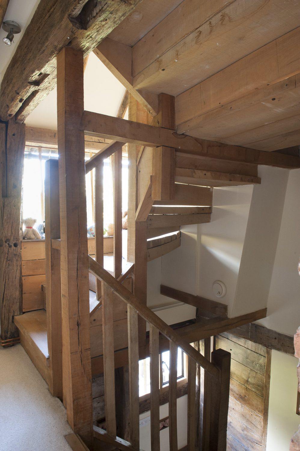 Green oak was used to make the stairs, primarily for its inherent flexible qualities which allowed it to mould around the huge central chimney and move with the varying temperatures within the house