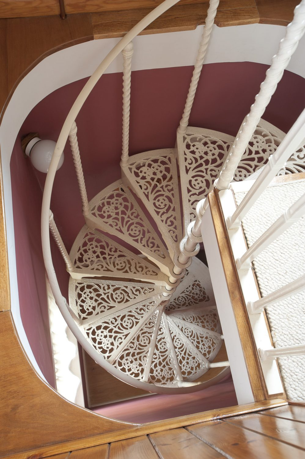 The intricate wrought-iron spiral staircase