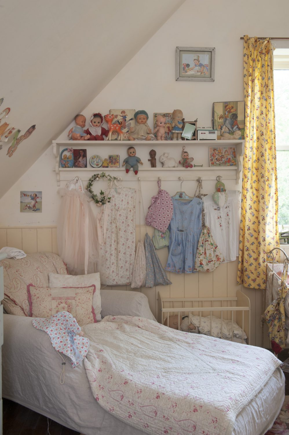 Bibby's room is a delightful mix of buttermilk yellow and shell pink