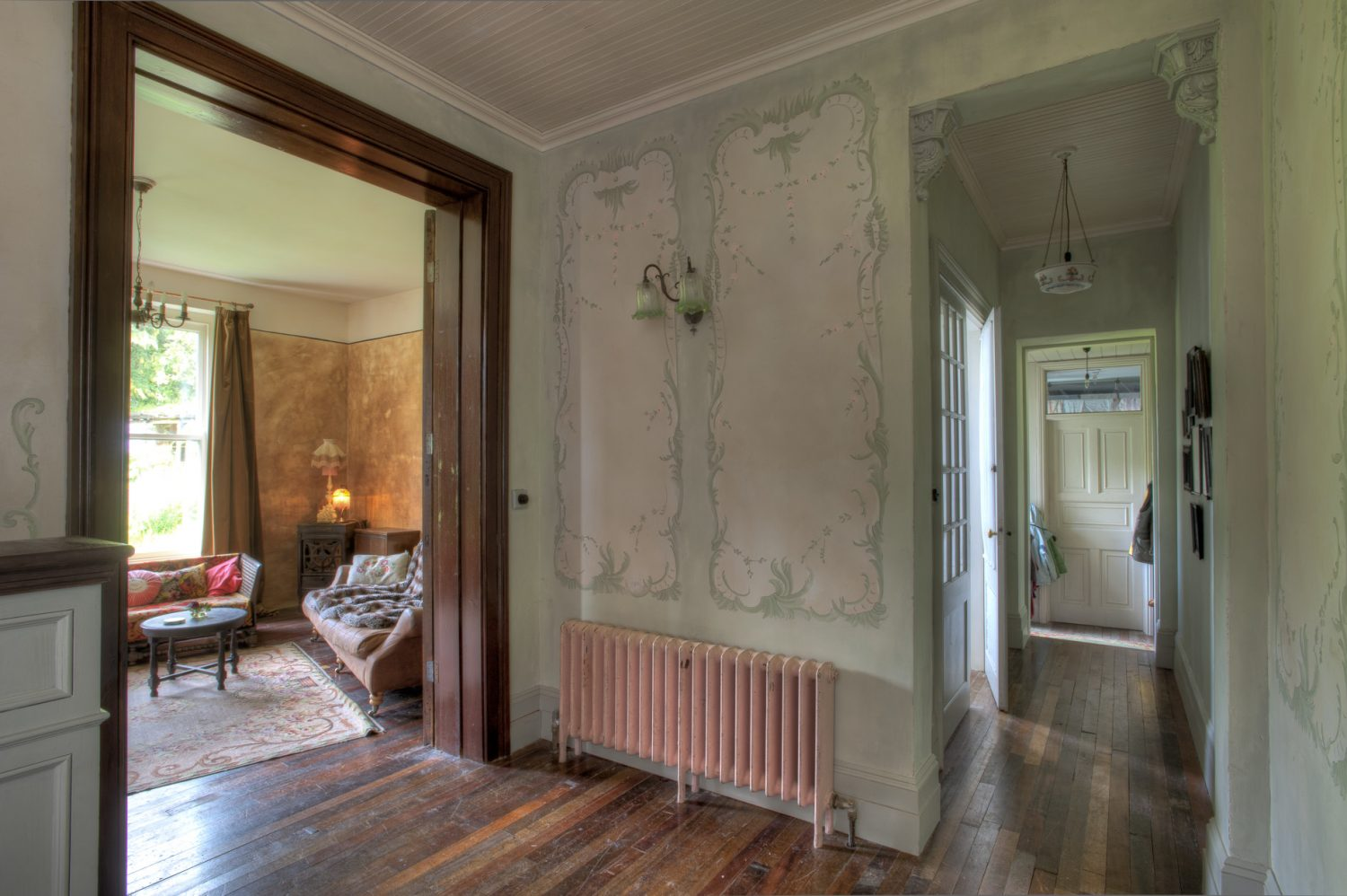 Susan's delicately painted trompe l'oeil wall panels are a striking feature throughout the house