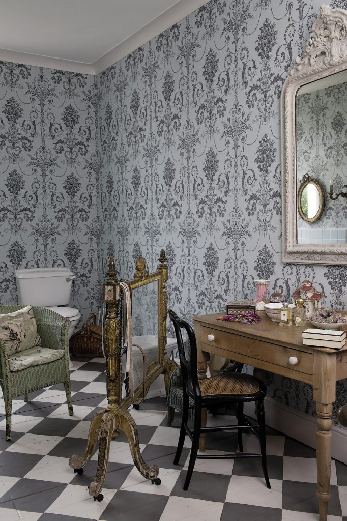 The bathroom on this floor. The wallpaper is a duck egg blue and charcoal grey damask style pattern from Laura Ashley and sets the tone for the space