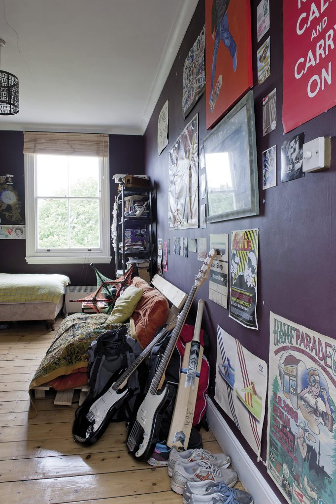 Orlando and Joanna's son's room is painted a deep aubergine purple