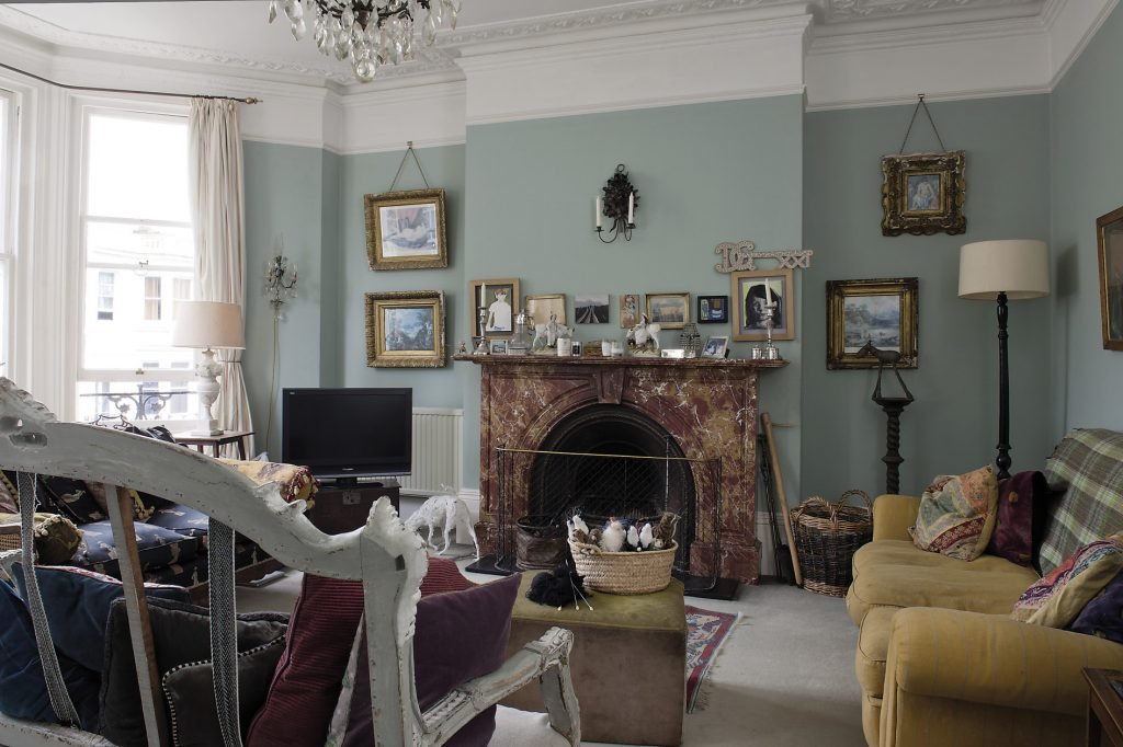 The drawing room is home to several sofas and chairs in the room, including a rather ornate French wooden one that has only been upholstered on its seat, leaving the wooden structure at the back completely open like vertebrae of a skeleton