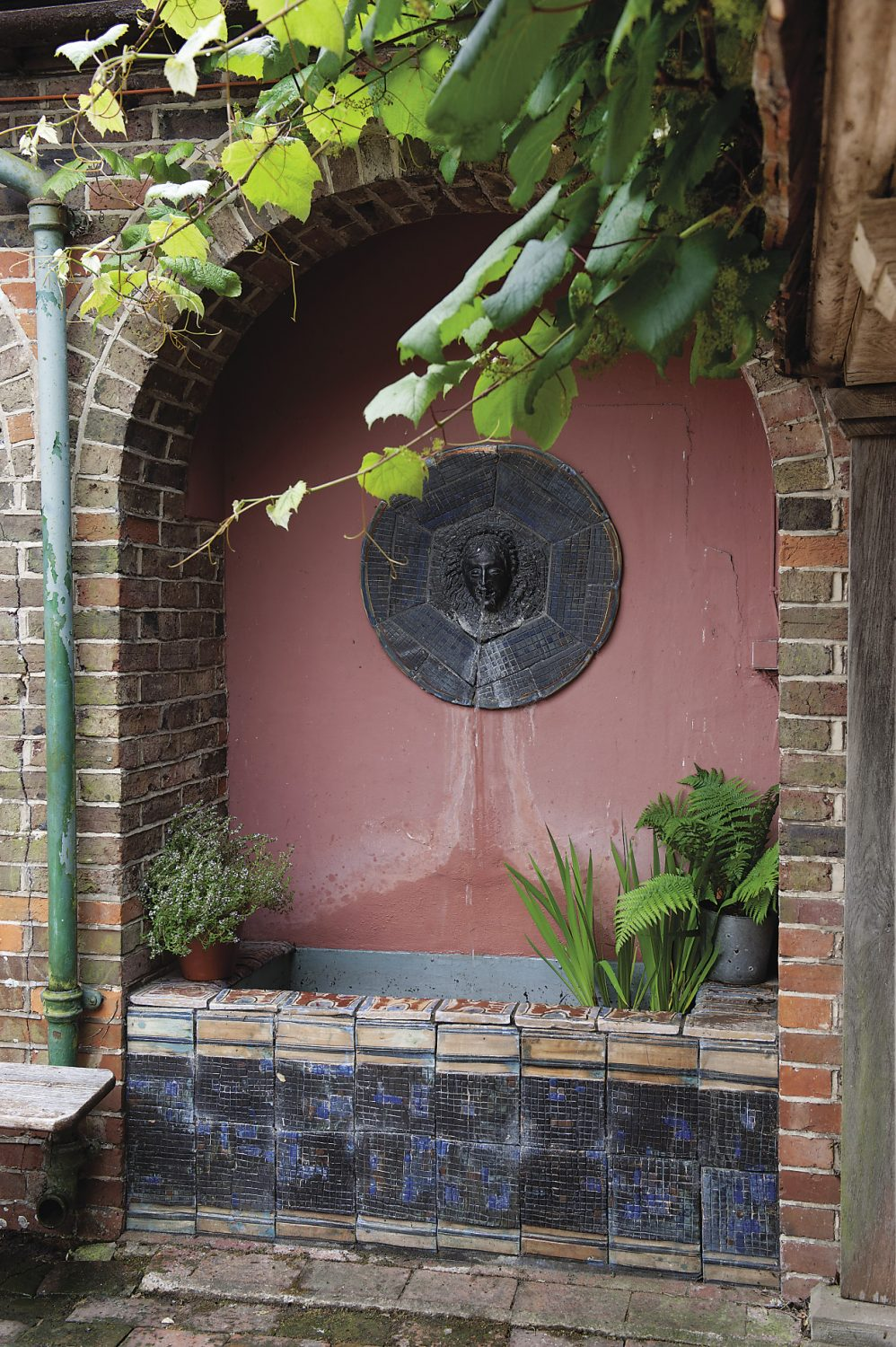 "The tiled fountain that Duncan Bell created. ""We've just got it working again and it's wonderful to have the tinkling sound of the water carrying through into the house,"" says Polly"