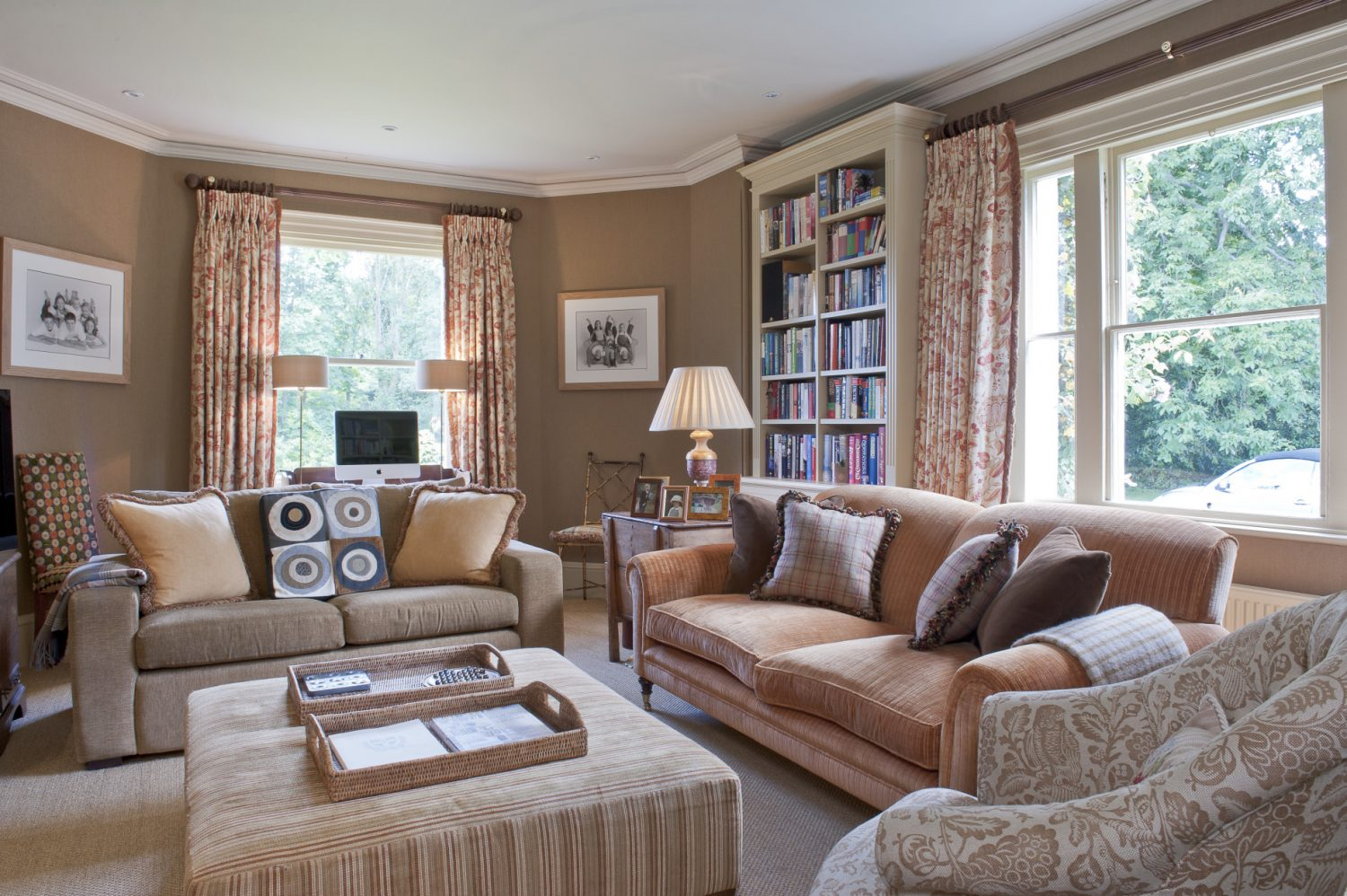 Belinda had the larger sofa in the snug re-upholstered in Lelièvre mogadore velvet so that it is fresh yet still looks like a loved family piece. The walls are hung with Casamance wallpaper giving the room the warmth and appearance of being fabric-lined.