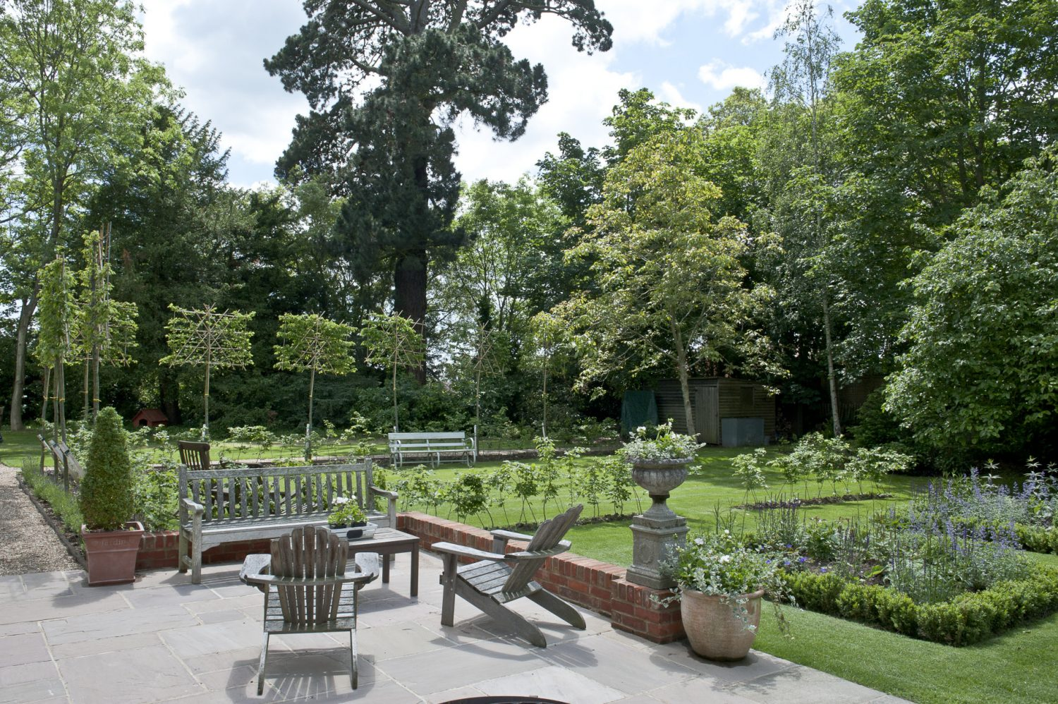Jo Thompson, a Chelsea gold-medallist, has re-designed the garden for Belinda. Jo's design includes a parterre leading off the terrace, the original of which has been extended to provide a larger seating area